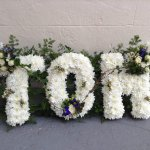 #### country letters with mixed foliage edging and posies £30 per letter