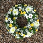 #### mixed open wreath  with seasonal flowers in any colours 
