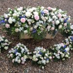 #### Country flowers casket spray 3ft £95  4ft £125  5ft £155 matching posies £30 each all colours