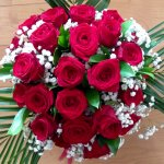 24 red roses with gypsophila and ruscus in a water box with a bow £49